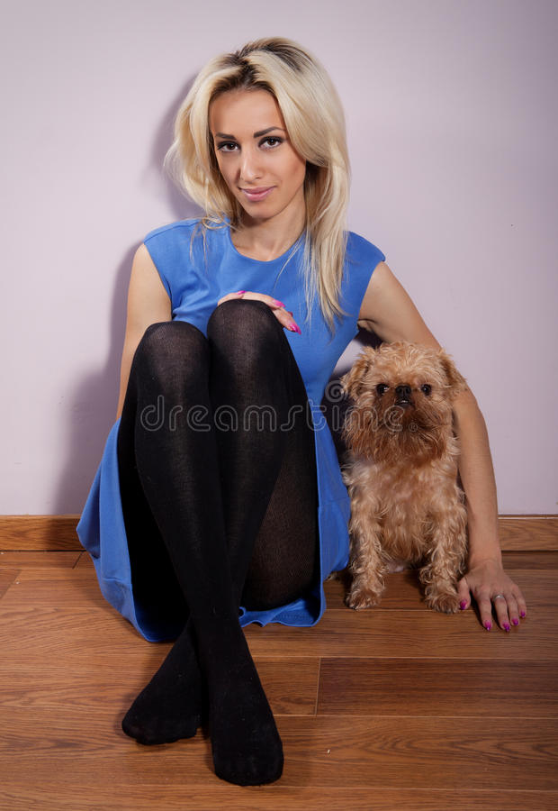 Woman with a dog. Young woman with a dog breed Griffon Bruxellois stock images