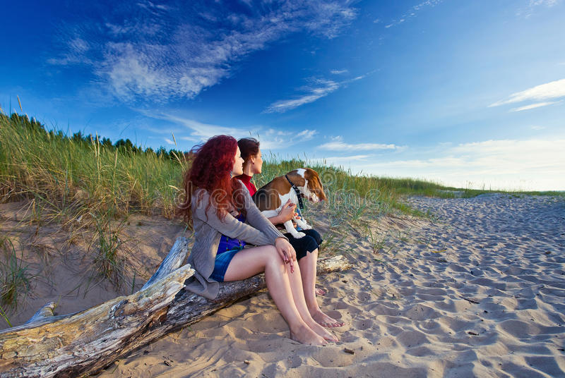 Woman with dog. Two women with dog on a sea beach royalty free stock photos