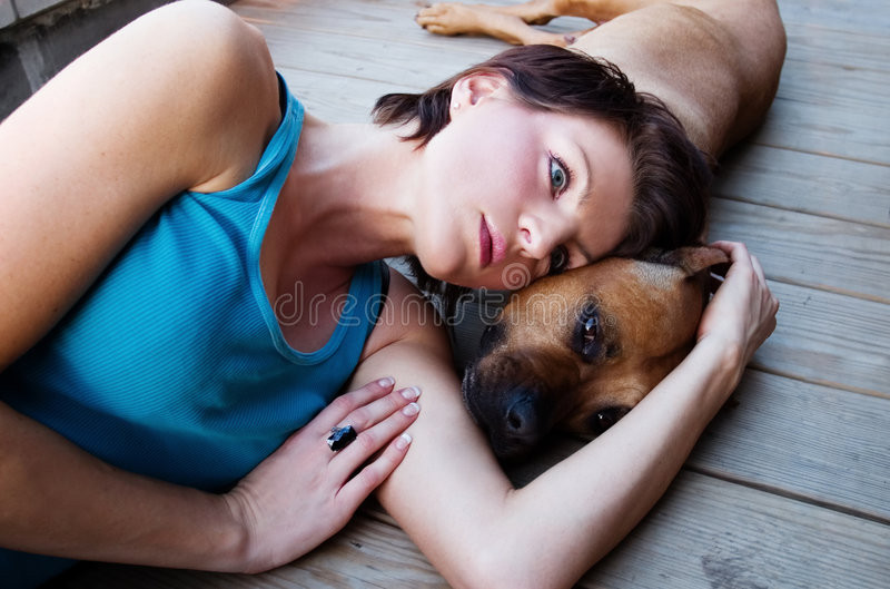 Woman and a dog royalty free stock photos