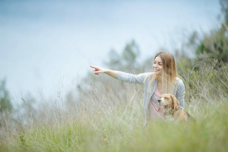 Woman with a dog in nature. royalty free stock image