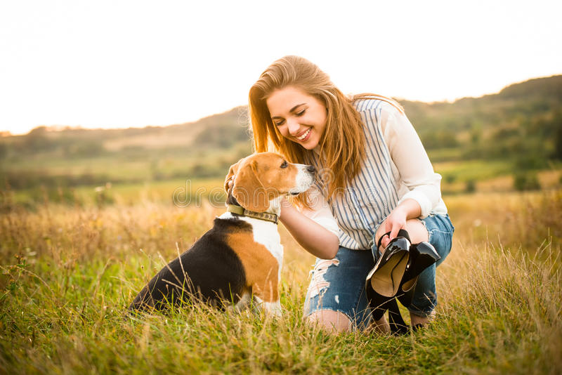 Woman and dog in nature royalty free stock photography