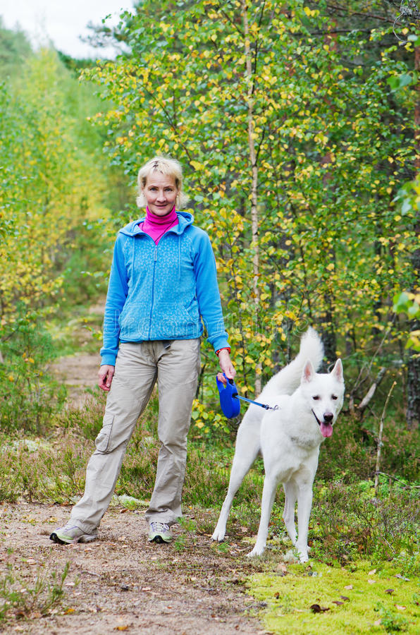 Download Woman With A Dog Walk In An Autumn Wood Stock Photo - Image: 28892624
