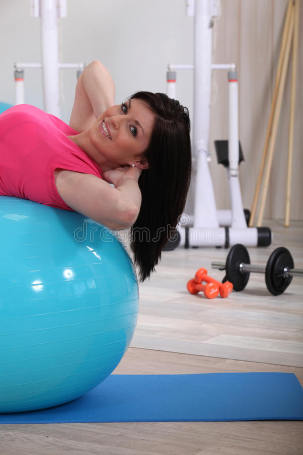 Woman doing ab exercises stock photography
