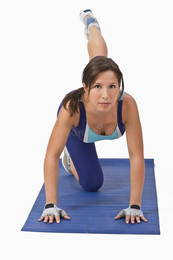 Woman doing aerobics stock photo