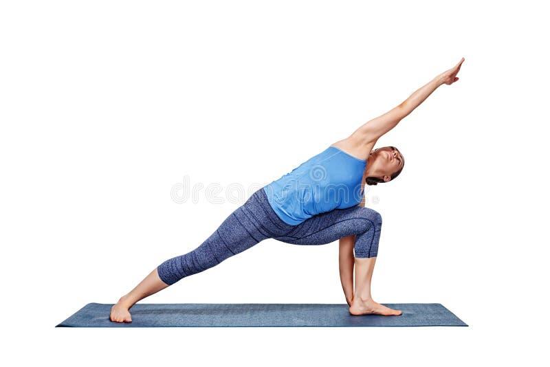 Download Woman Doing Ashtanga Vinyasa Yoga Asana Utthita Parsvakonasana Stock Image