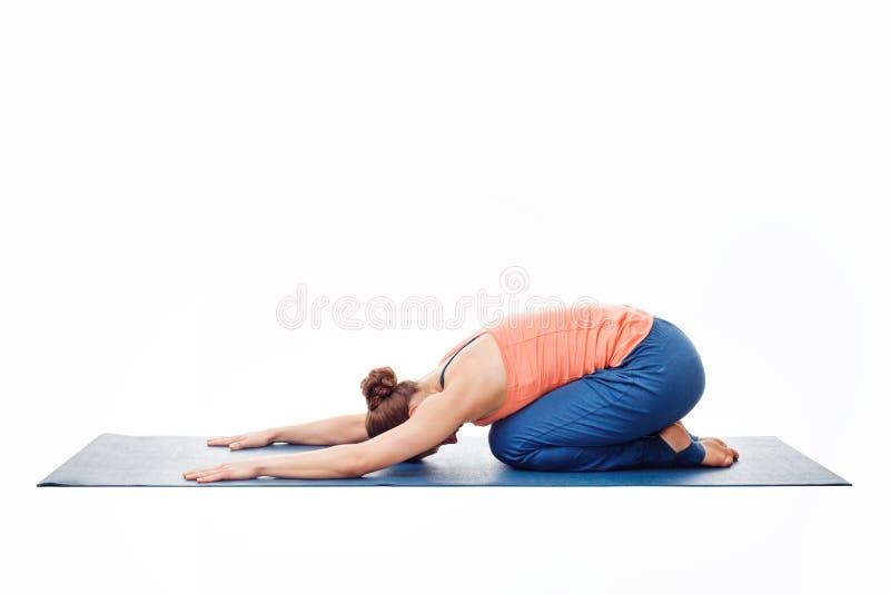 Woman doing Ashtanga Vinyasa Yoga relaxation asana Balasana chil. Woman doing Ashtanga Vinyasa Yoga relaxation asana Balasana - child posture - resting pose or stock image