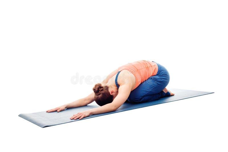 Woman doing Ashtanga Vinyasa Yoga relaxation asana Balasana chil. Woman doing Ashtanga Vinyasa Yoga relaxation asana Balasana - child posture - resting pose or stock photo