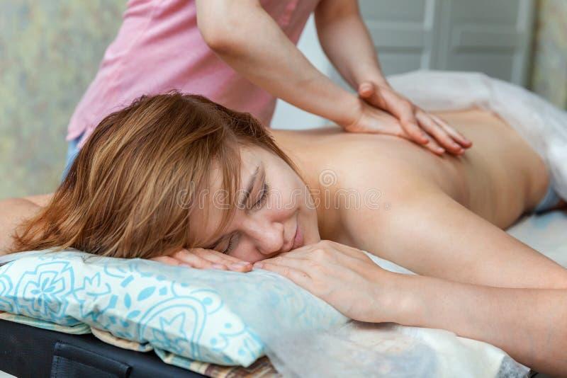 Woman doing back massage royalty free stock photos