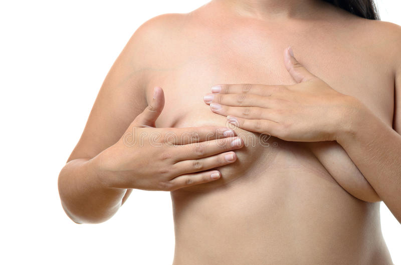 Woman doing a breast examination royalty free stock images