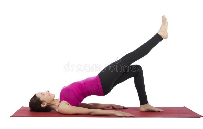 Woman doing Bridge kick during fitness royalty free stock image