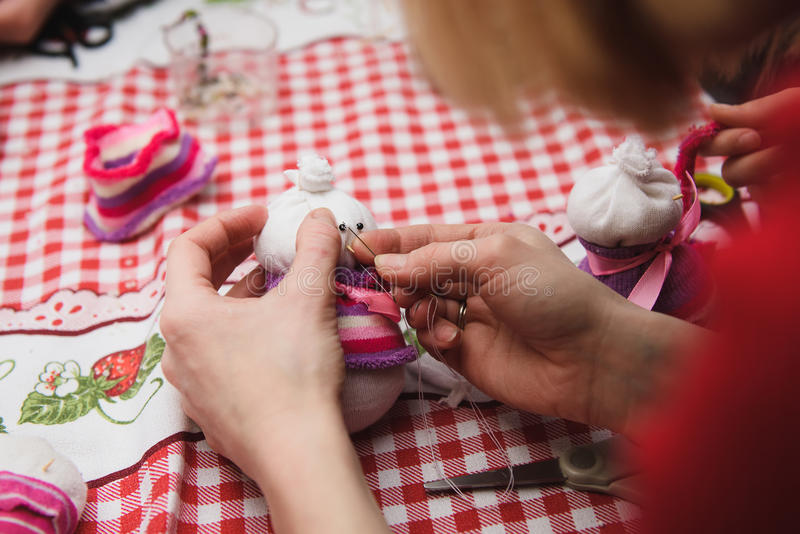 Woman doing Christmas crafts royalty free stock image