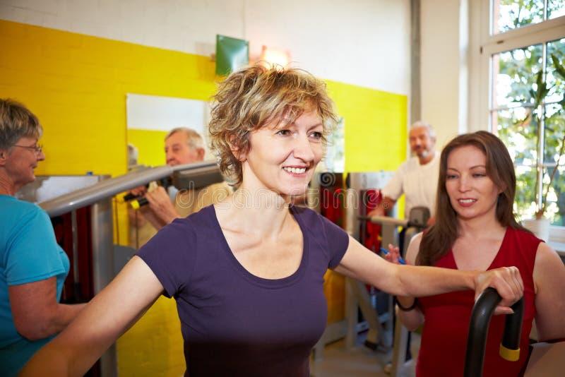 Woman doing circuit training royalty free stock photos