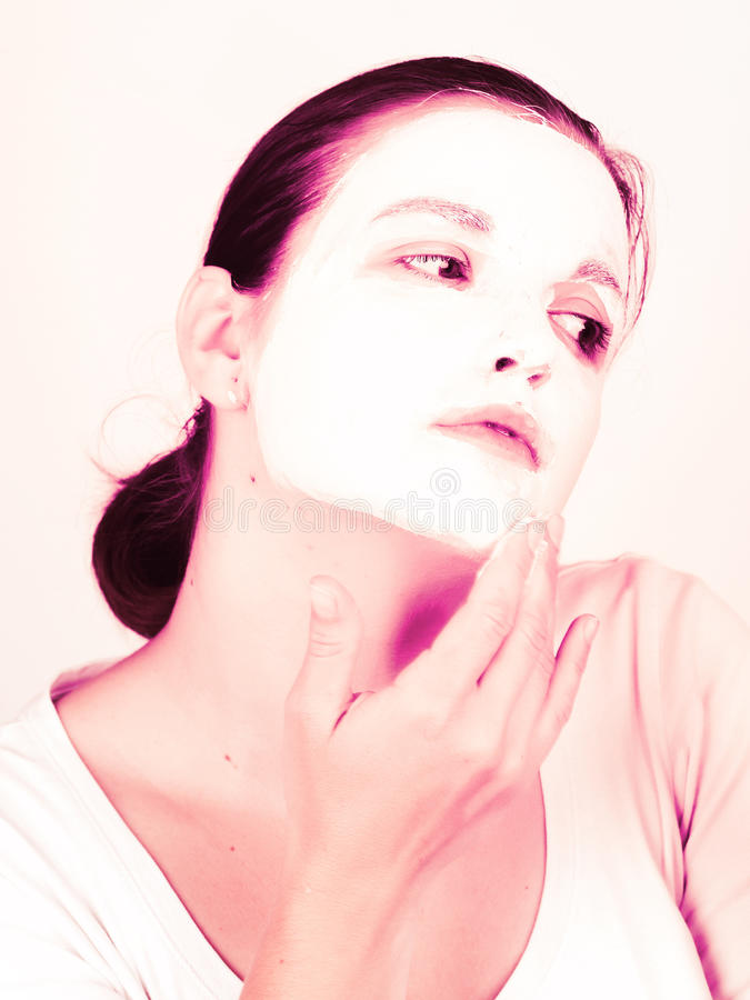 Woman Doing Cosmetic Mask Stock Images