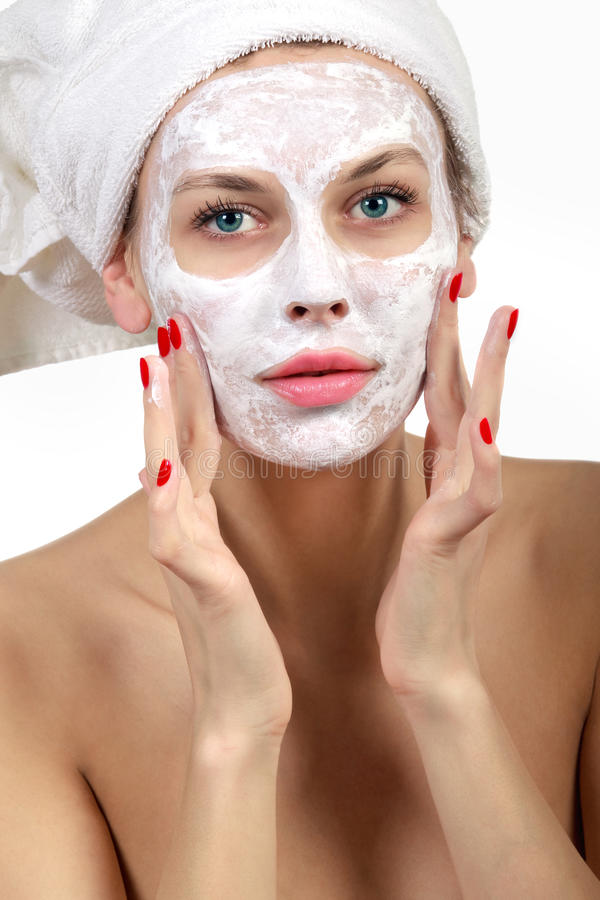 Download Woman doing cosmetic mask stock photo. Image of putting - 26998426
