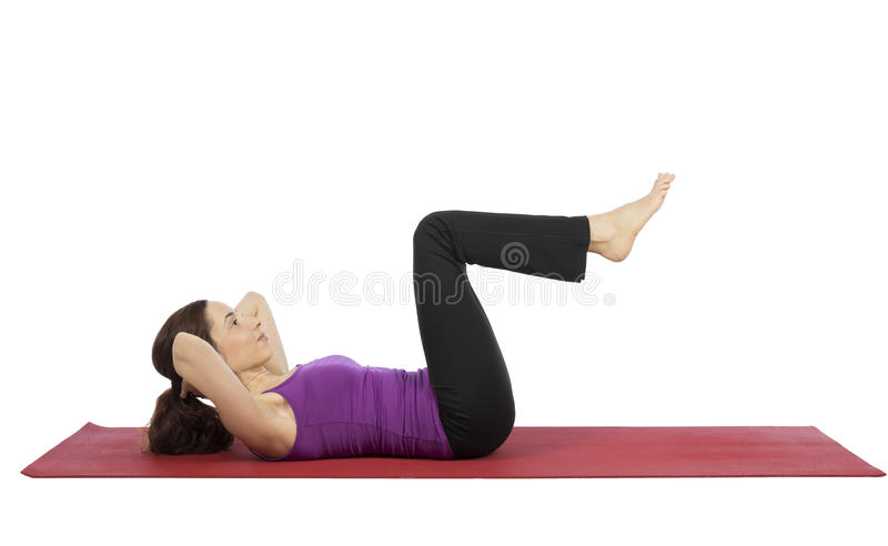Woman doing crunch during fitness stock photography