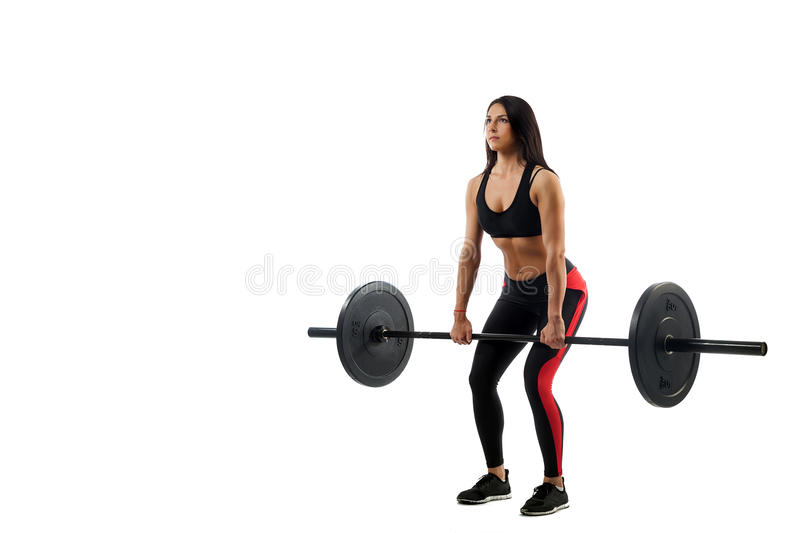 Woman doing deadlift royalty free stock photography