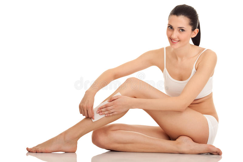 Woman doing depilation royalty free stock photography