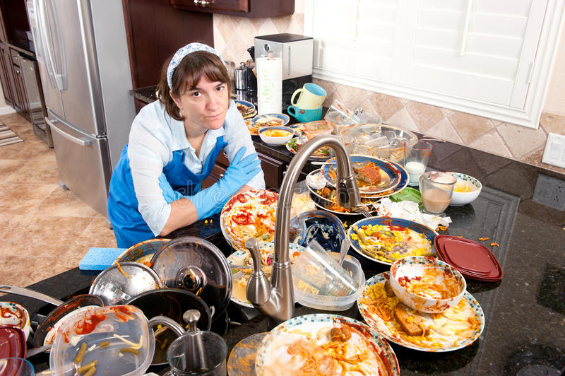 Woman doing the dishes stock photography