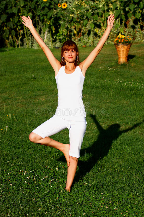 Download Woman doing exercise stock photo. Image of garden, nature - 20870144