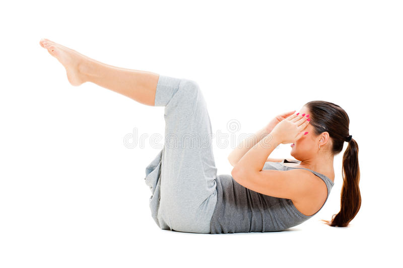 Woman doing exercises for abdominal muscles stock photos