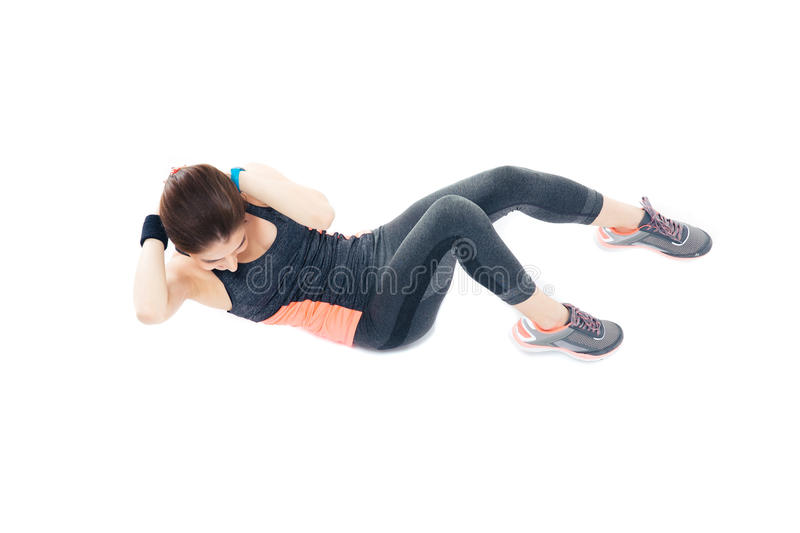Woman doing exercises for abdominal muscles royalty free stock photography
