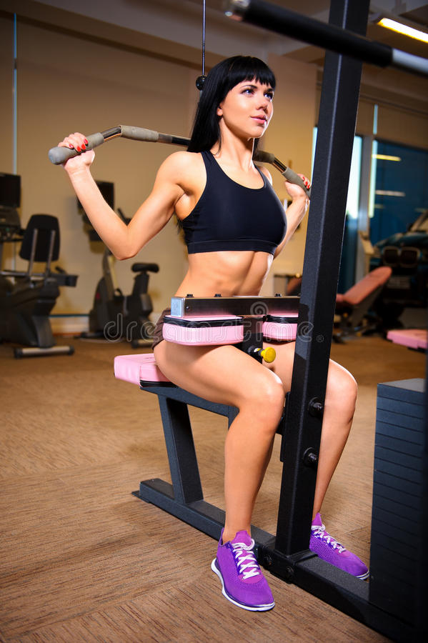 Woman doing exercises at the gym royalty free stock photos