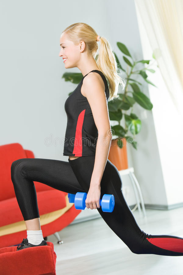 Woman doing exercising. Woman exercising with dumb bells royalty free stock photos