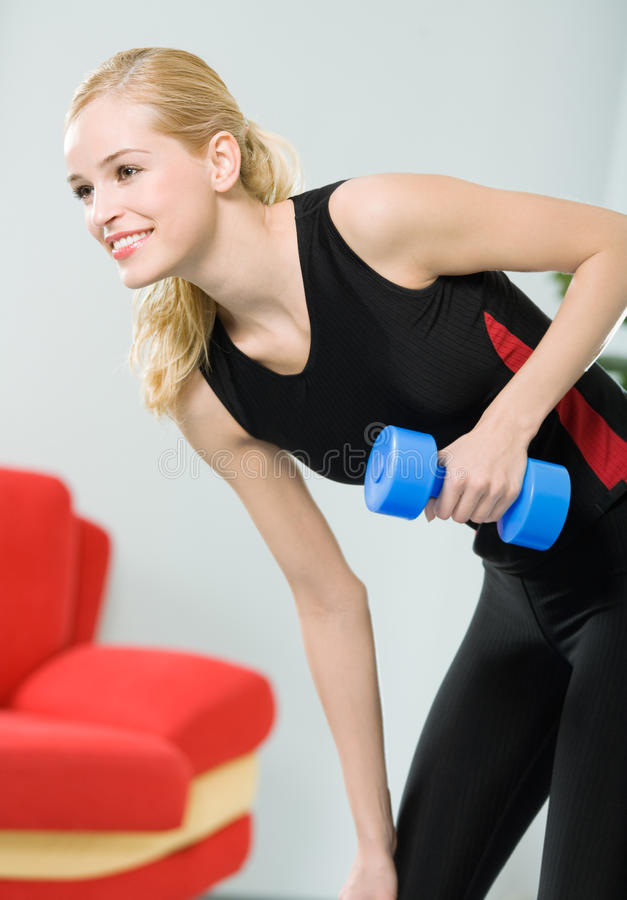 Woman doing exercising. Woman exercising with dumb bell royalty free stock photo