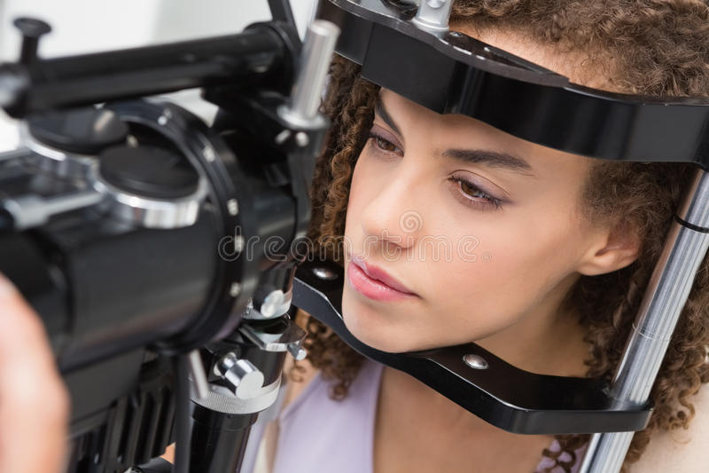 Woman doing eye test royalty free stock image