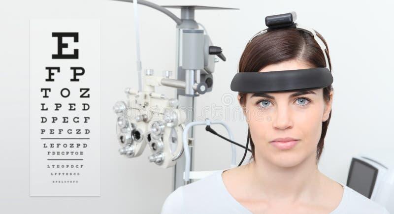 Woman doing eyesight measurement, balance test and visual chart stock photos