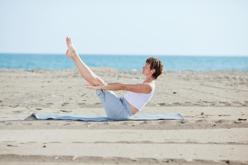 Download Woman Doing Fitness Exercise On Beach Stock Photo - Image: 16246710