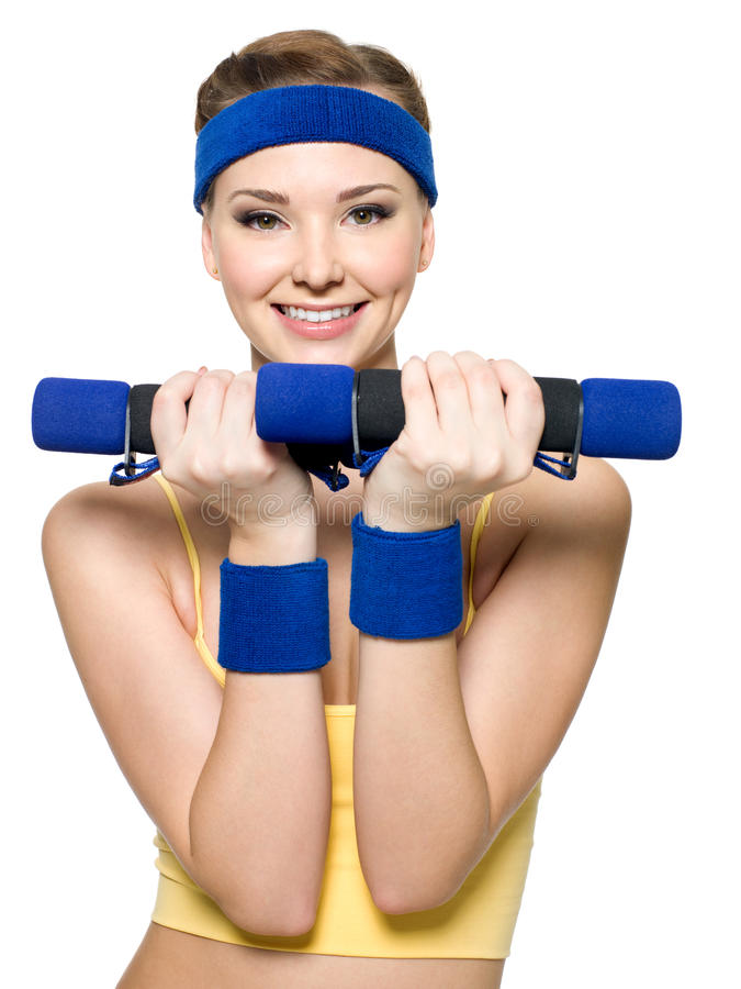 Woman doing fitness exercise with dumbbells stock photos