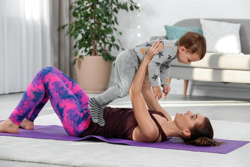 Woman doing fitness exercises together with son royalty free stock images