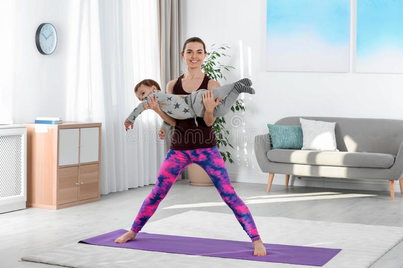 Woman doing fitness exercises together with son royalty free stock photo