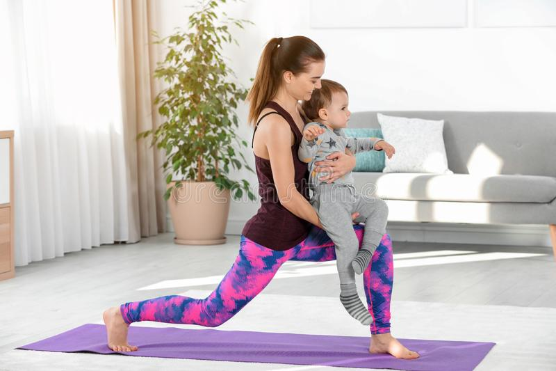 Woman doing fitness exercises together with son stock image