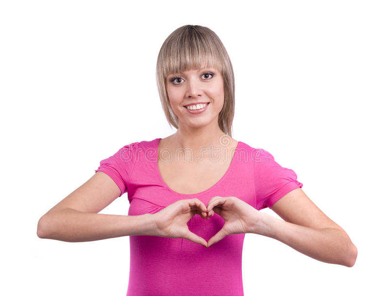 Woman doing a heart symbol with her hand