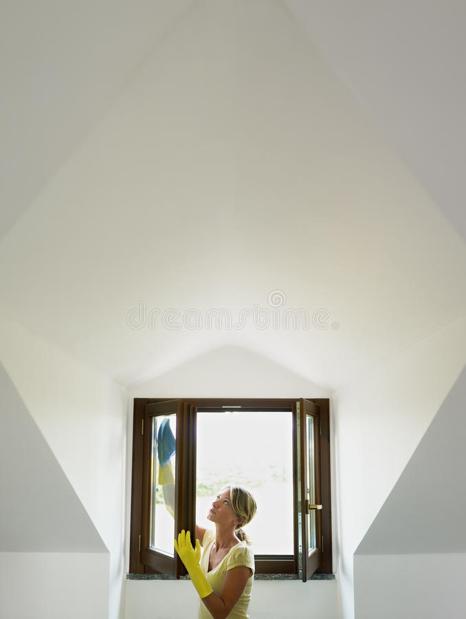 Woman doing housework royalty free stock photo