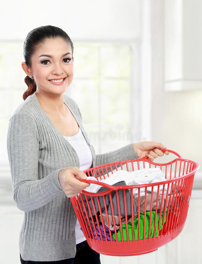 Woman with a basket of loundry stock photos