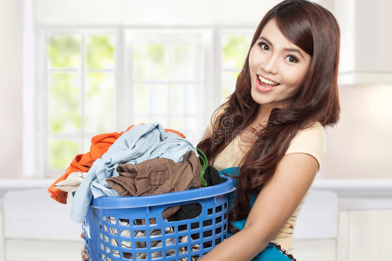 Woman doing laundry royalty free stock image