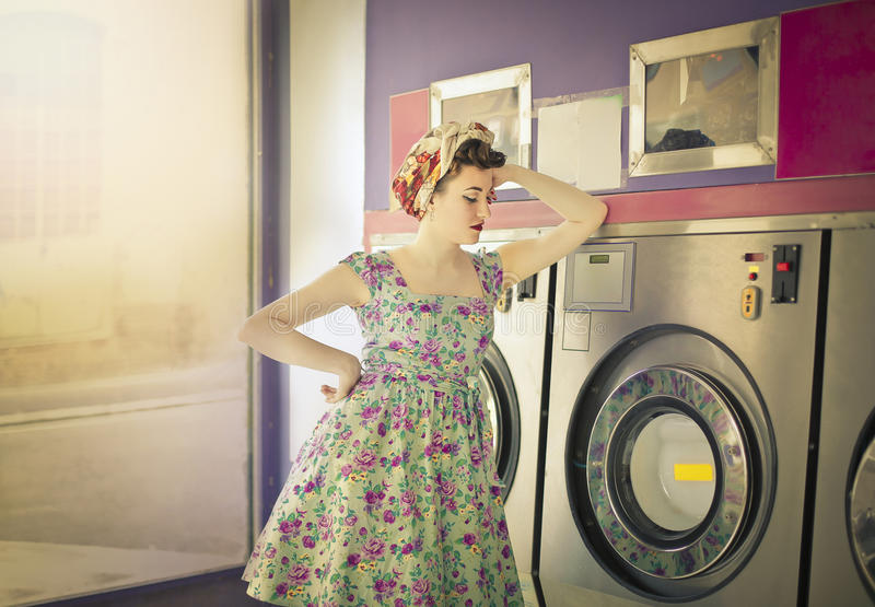 Woman doing the laundry royalty free stock images