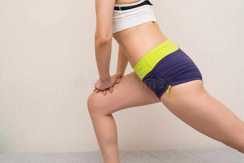 Woman doing leg stretching stock image