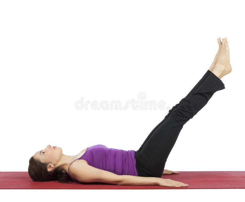 Woman doing legs and abs workout royalty free stock photography