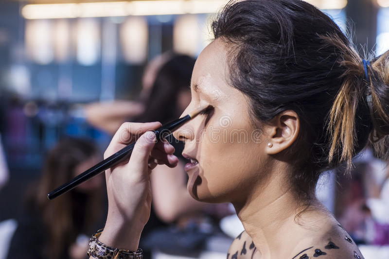 Woman Doing Make-up On Face With Cosmetics Editorial Image