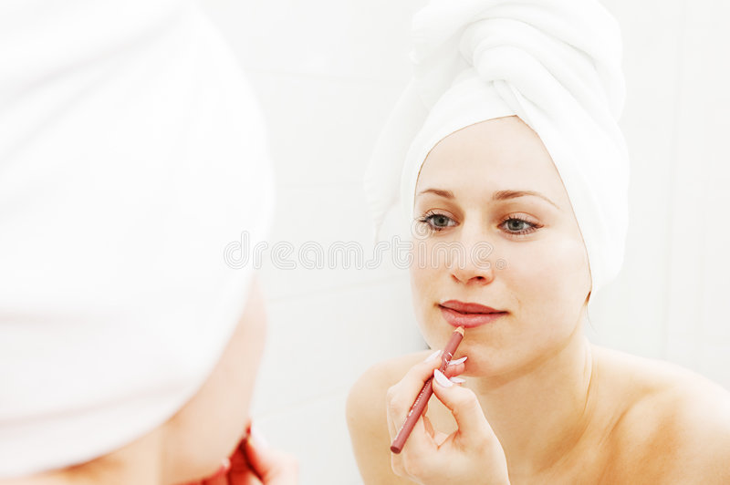 Woman Doing Make-up After Shower Stock Image