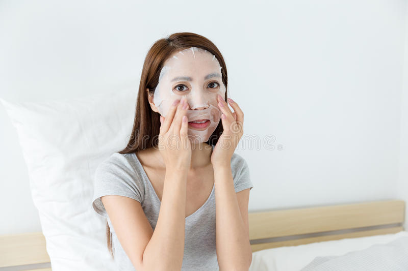 Woman doing masking. At home stock photo