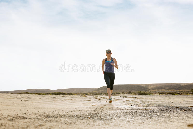 Woman Doing Morning Jog in the Desert stock photos