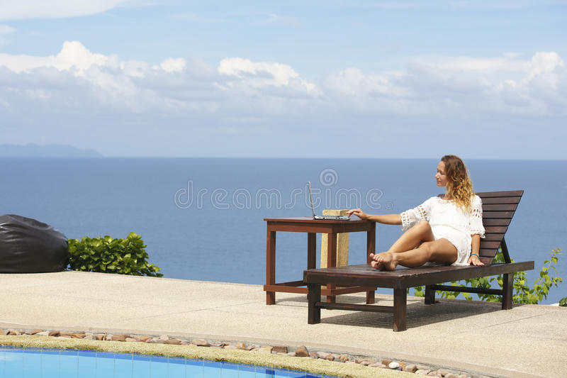 Woman doing online shopping outdoors. stock photography