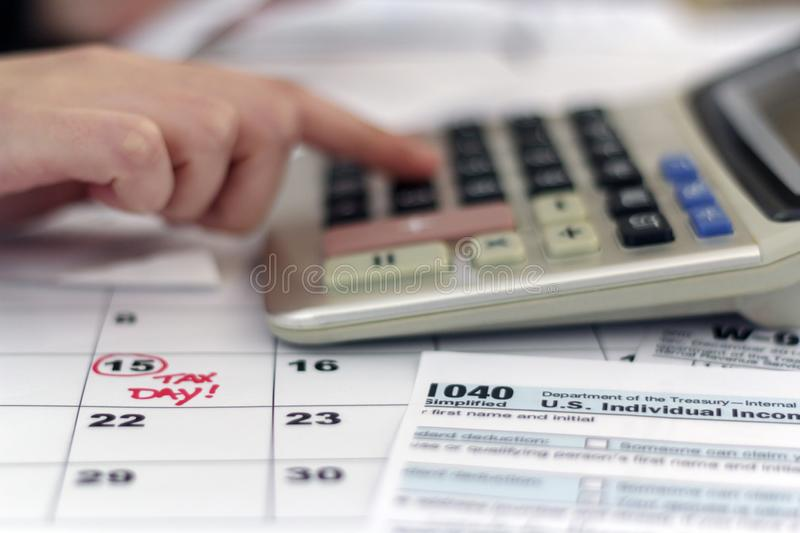 Woman doing paperwork for paying taxes stock photography