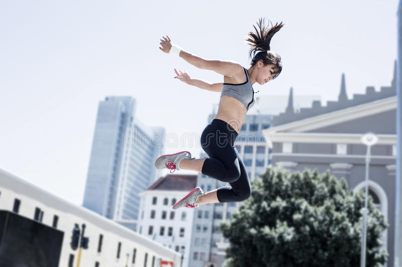 Woman doing parkour in the city stock photo