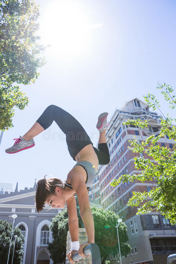 Woman doing parkour in the city stock images